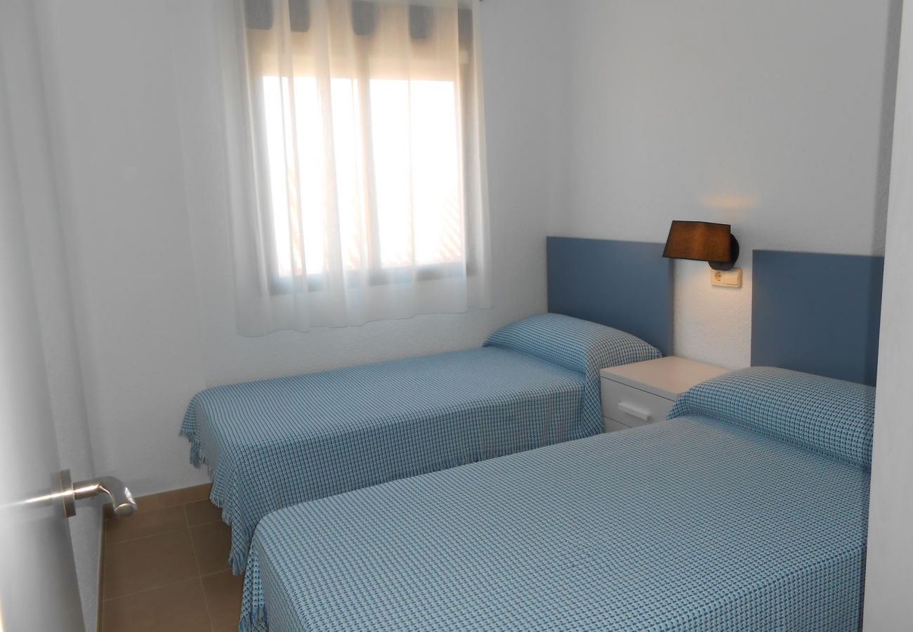 Double bedroom with small table and built-in wardrobe